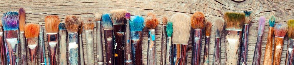 bigstock-Row-Of-Artist-Paintbrushes-Clo-80986595.jpg