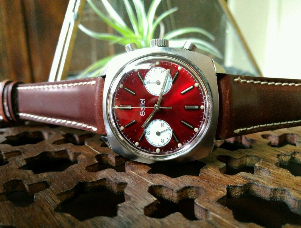 I love the deep ruby red dial on this pretty clean watch.  Photo courtesy of eBay listing, click through for more details.