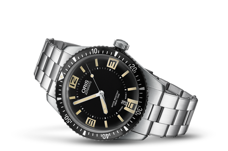 This might be my favorite configuration with the large exposed crown, riveted oyster bracelet, big lume plots, lollipop seconds hand and ladder style hour hand all true to a vintage diver. Photo courtesy of Oris' website, click through for more details.