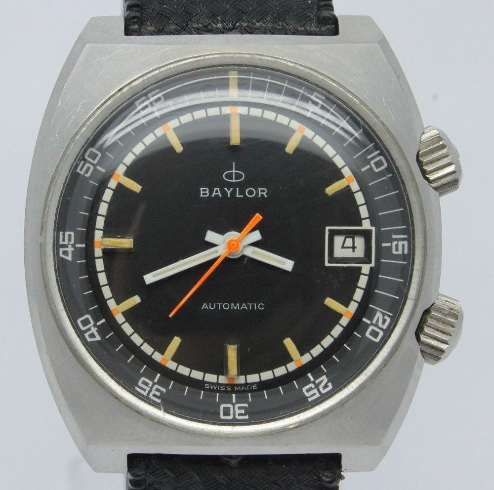 "It's not a true ""compressor"" case, but this super compressor style diver with the two crowns has all sorts of funky 70's character.  Photo courtesy of eBay listing, click through for more info."