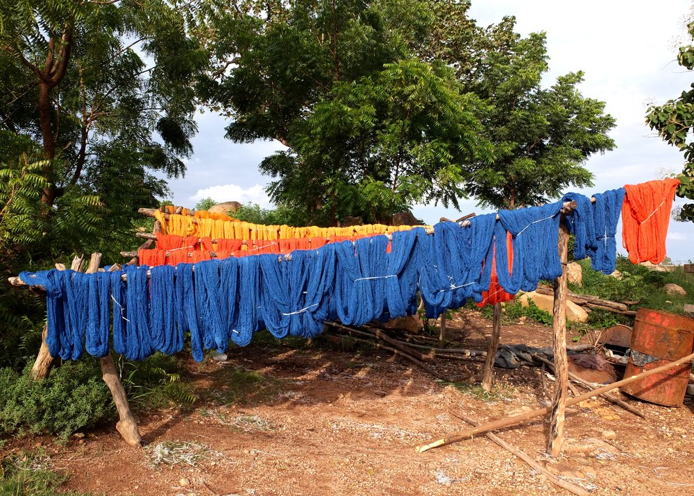 Freshly dyed thread drying in the sun