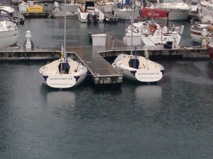 The Sail Sheboygan Sonars sitting in the rain.