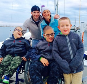 The Shaw family poses on the dock after sailing.
