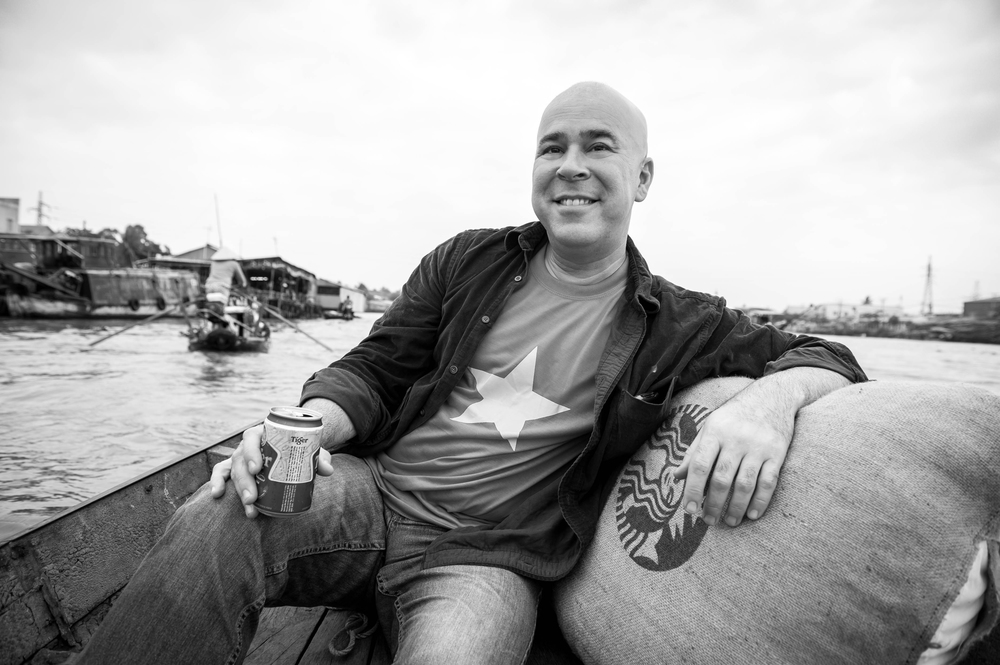 "In 2012, working as the Creative Manager of Starbucks Global Concept Design, I traveled the world with National Geographic photographers to generate new images for Starbucks locations worldwide. Here, I'm in the Can Tho floating market in Vietnam working with World-Press-winning photographer, Ami Vitale. Banner photo at the top of the page: On the set of our ""7 Deadly Zins"" photo shoot with creative, cast and crew"