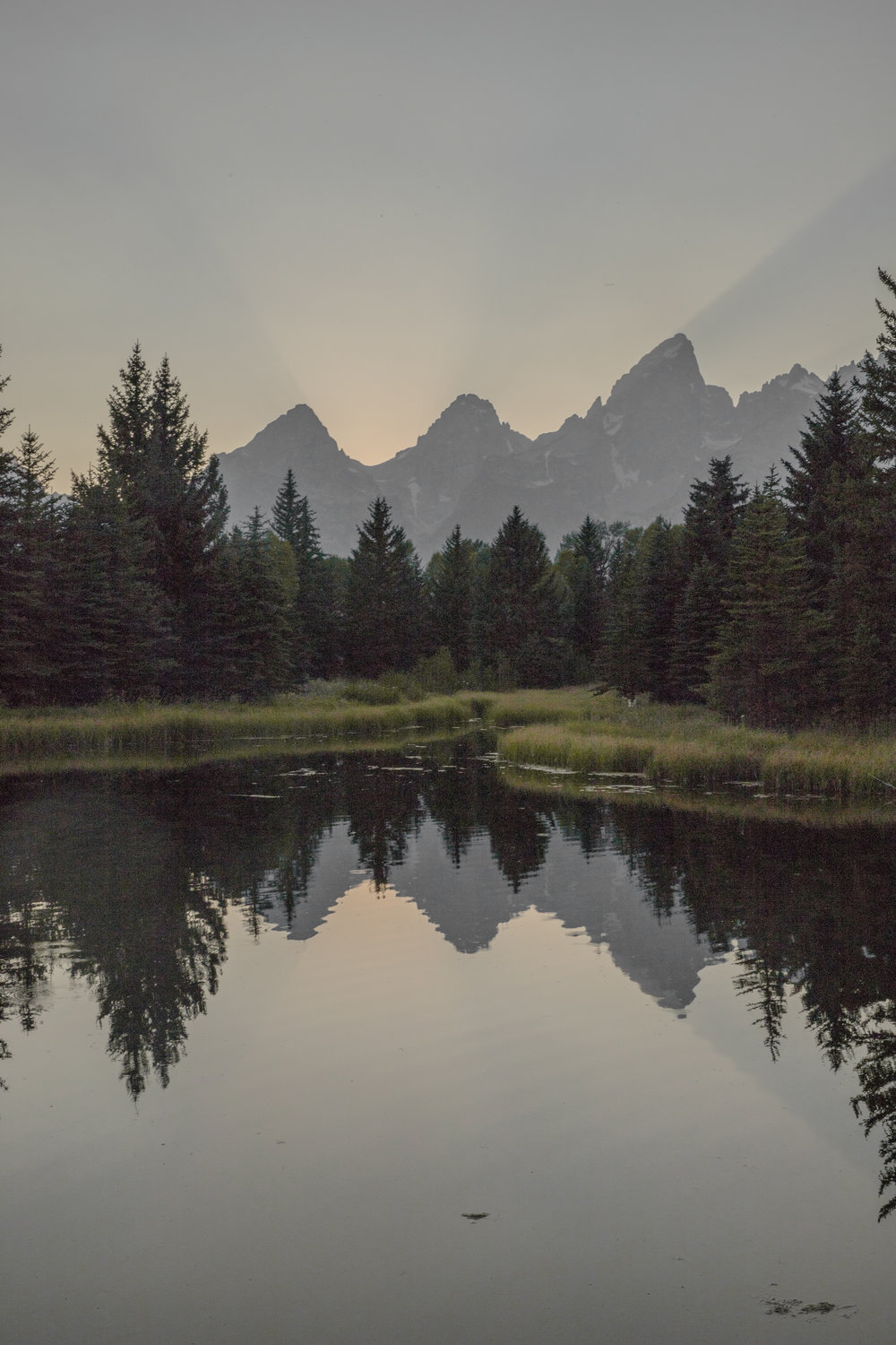 Sunset at Schwabacquers Landing in Grand Tetons.