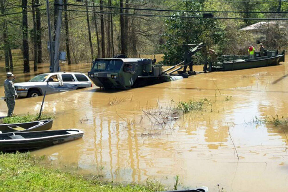 The Lousiana National Guard assists in the relief efforts.