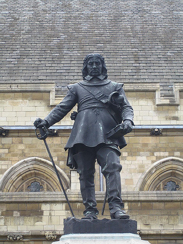 The statue of Oliver Cromwell outside the Houses of Parliament (the Palace of Westminster) in London