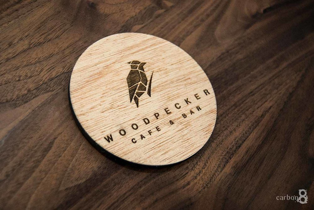 Laser cut coaster for Woodpecker Cafe