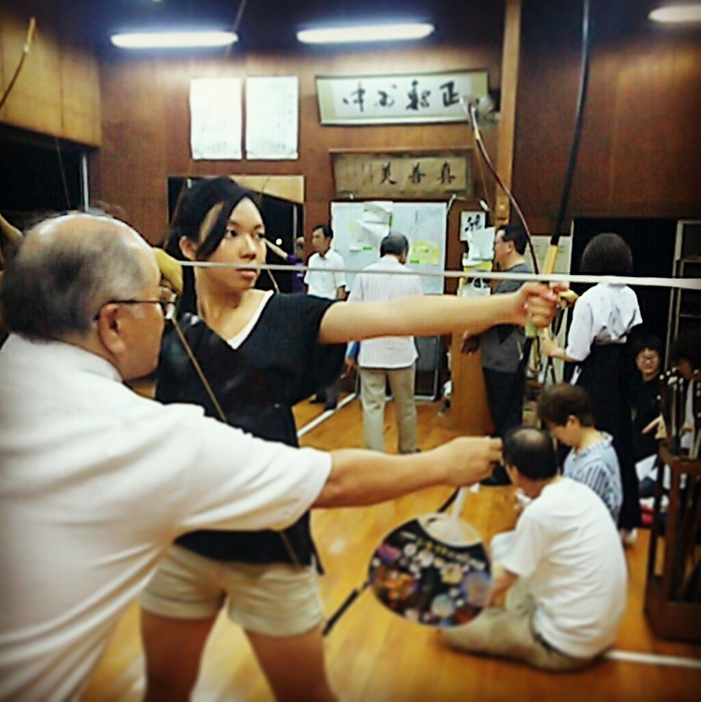 Practicing kyudo (Japanese archery) at host sister's high school club building