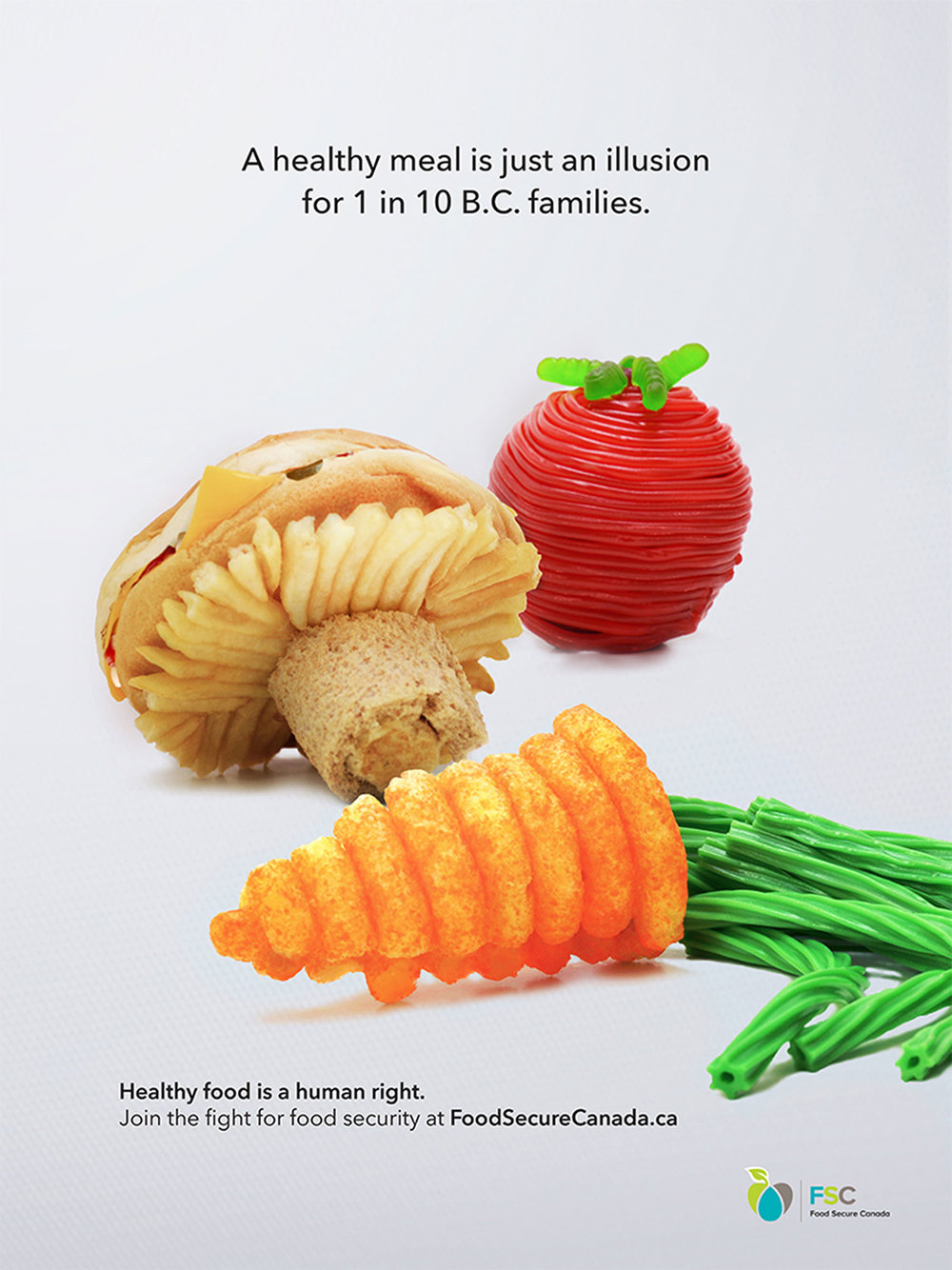 """For her world hunger campaign, Shay decided that she wanted to research what hunger looked like at home in Canada, and specifically British Columbia. In her research, she found that 1 in 10 B.C. families can't afford healthy food on a regular basis, and that this is called """"food insecurity"""". Her print ad aims to bring awareness to this issue by showing the audience that for someone going through food insecurity, healthy food is elusive.  """"The idea came to me pretty fast,"""" says Shay. It was one of her top five first ideas and she knew it was a good one. The process of constructing the food and photographing it took one afternoon! """"Overall, it was a super quick ideation and production of everything!"""" she says."""