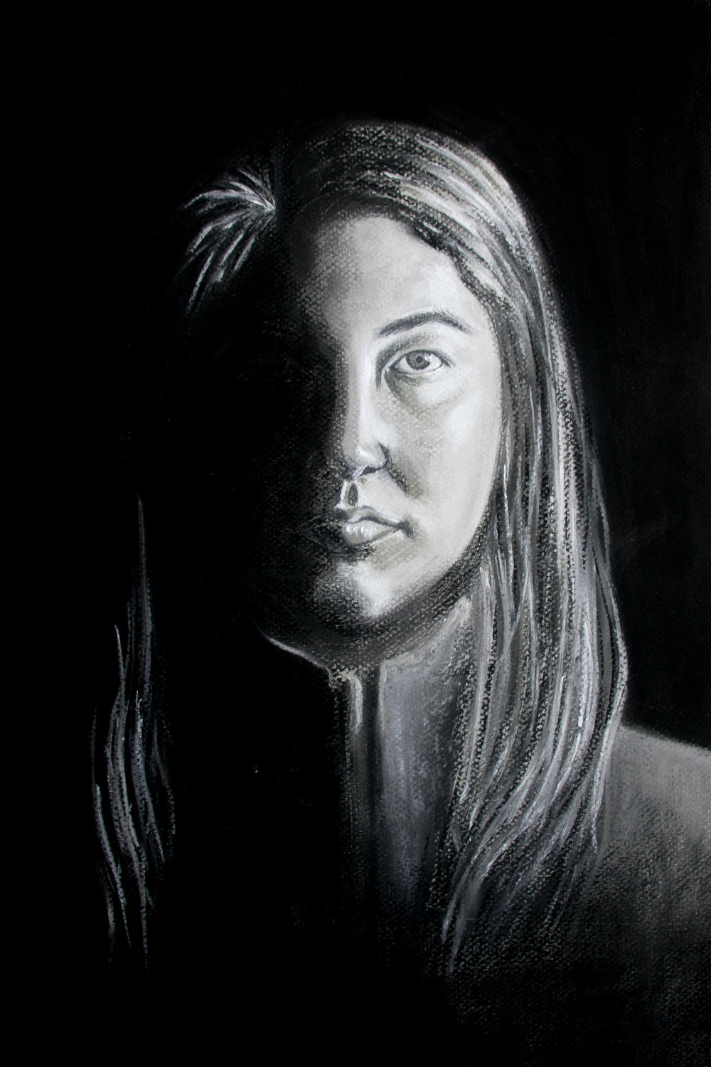 Black and White Charcoal Self-Portrait, Annika McFarlane (IDEA22)   This was an assignment for our life drawing class where we had to do a self-portrait without using photo reference, meaning we could only use a mirror. I chose to use hard light to emphasize the shadows, giving the left side of my face a lost edge.