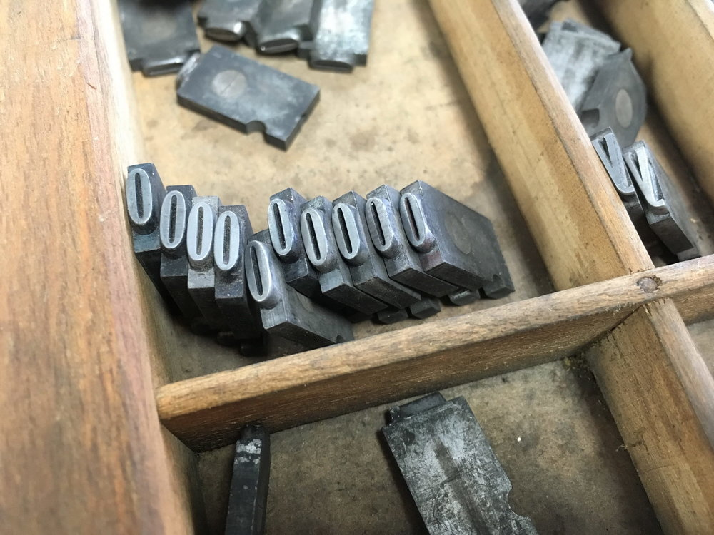 Metal letters in tray