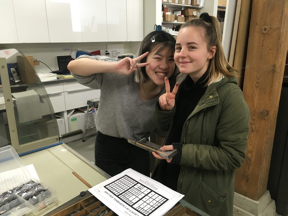 Emma Sun and Sarah Haglund using the job case chart for guidance