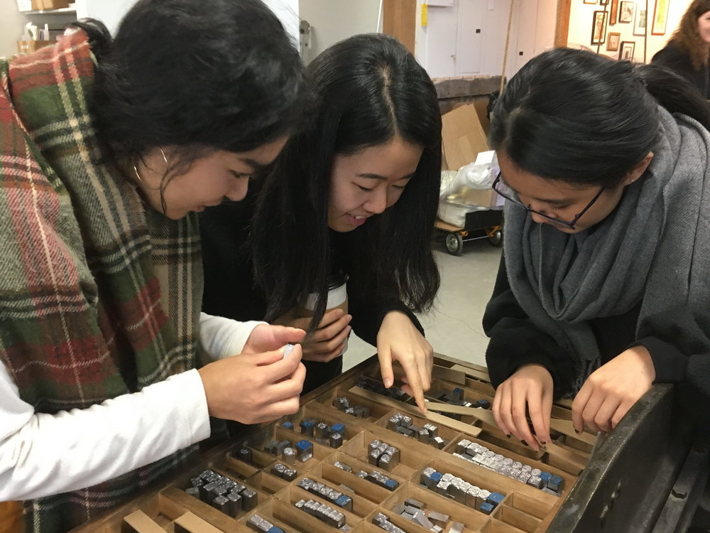Amy Asin, Haluka Yagi, and Sophie Young looking at ornament options