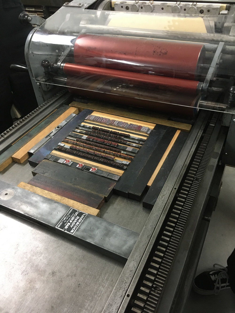Lines of text assembled on the Vandercook proofing press.