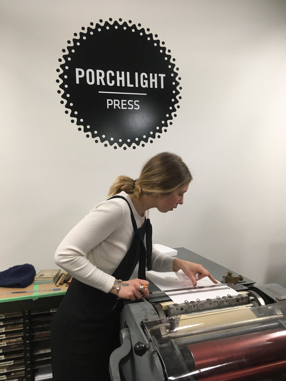 Annie Axtell demonstrates how to line up the paper