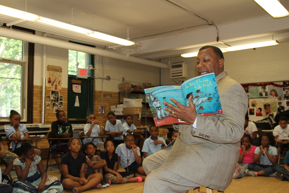 Sheriff Tompkins reading book at channing school.jpg