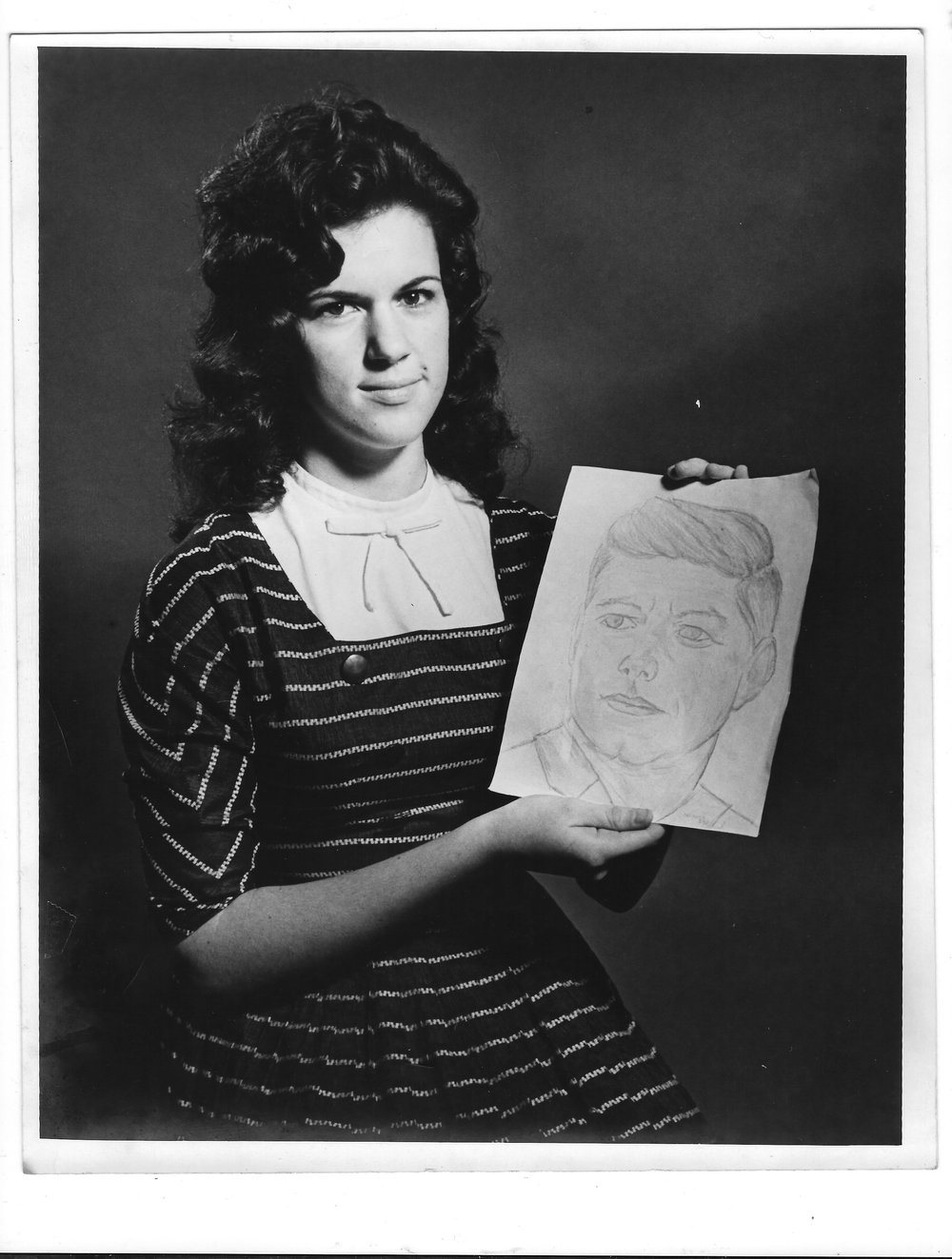 Linda Roupe with portrait of John F. Kennedy. Circa. 1963.