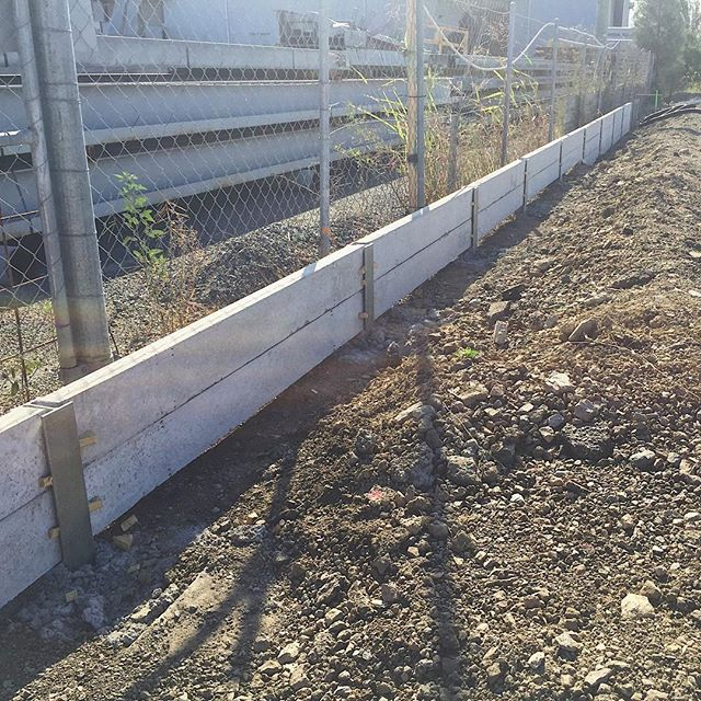 Here's a small concrete sleeper retaining wall being built by DNA Civil  #concretesleepers #walls #dnacivil #earthworks