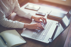 stock-photo-female-working-with-laptop-at-home-woman-s-hands-on-notebook-computer-writer-blogger-designer-353938376.jpg