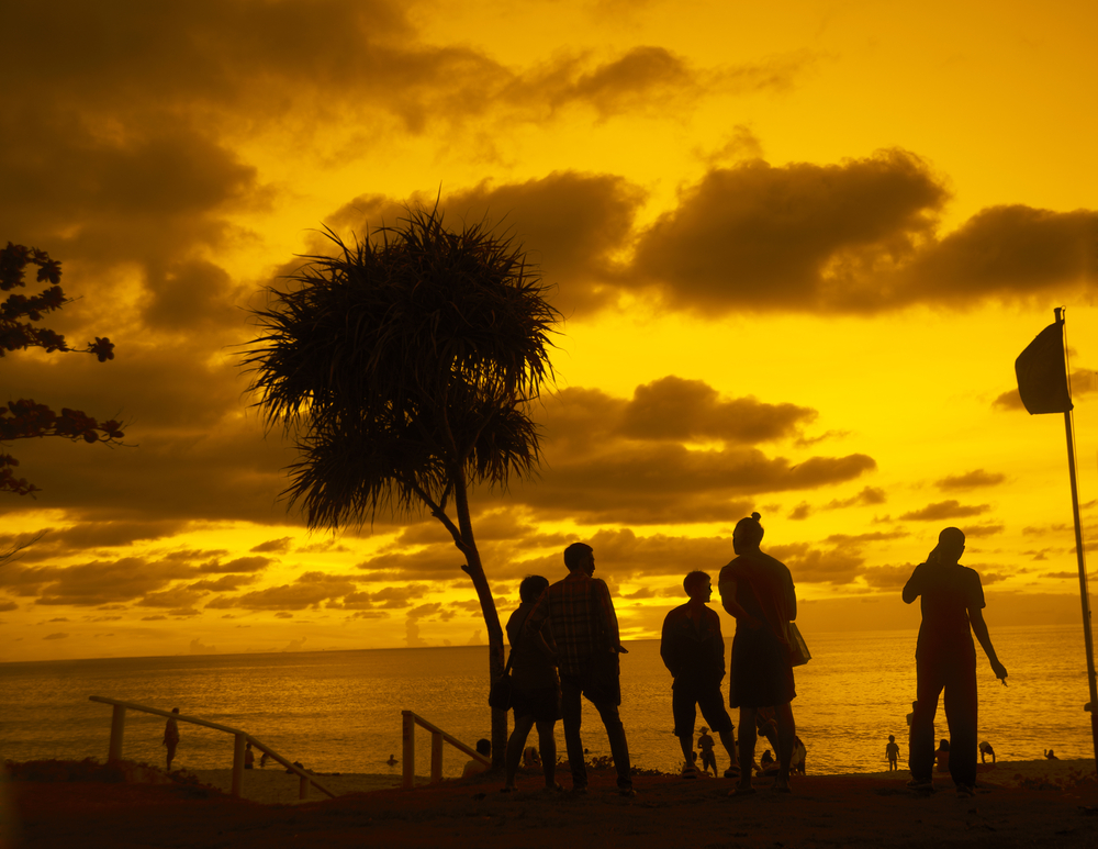 stock-photo-after-party-young-adult-people-on-hot-evening-summer-coast-beach-on-yellow-or-orange-dramatic-263893259.jpg