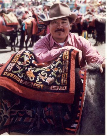 Tashi on horse with saddle rug.jpg