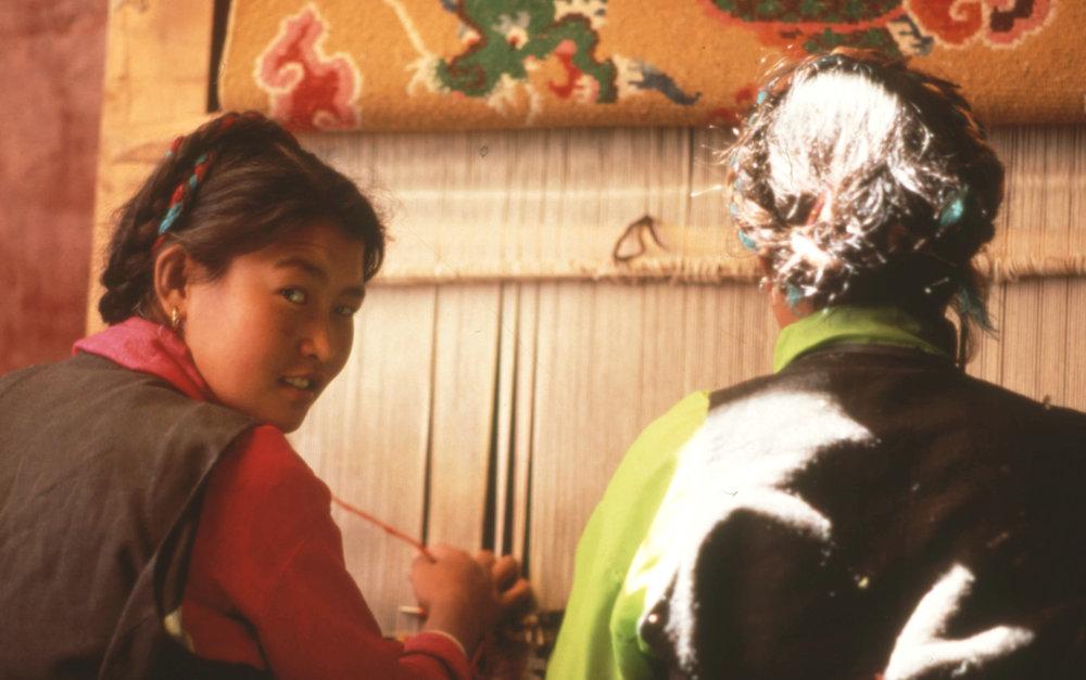 Weaving- 2 weavers on loom.jpg