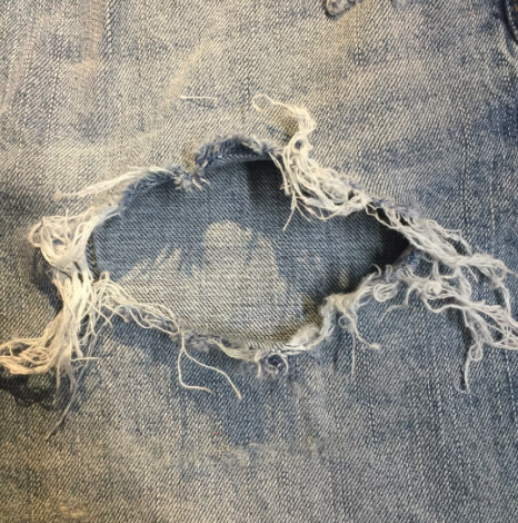 Step 1:  - Cut a denim or other fabric square large enough to cover the hole.