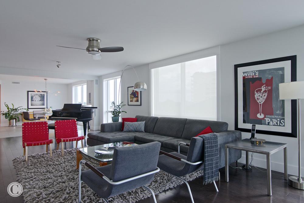 Jax Bch. Renovation, Acquilis Condominium, Living Room with View to Dining Area | Cornelius Construction Company