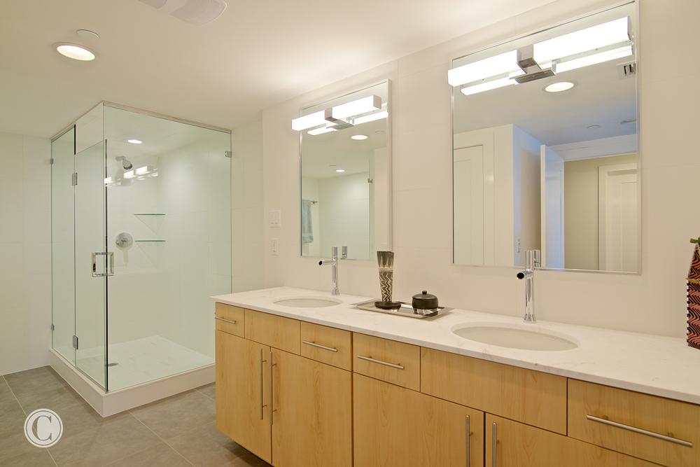 Jax Bch. Renovation, Acquilis Condominium, Guest Bathroom | Cornelius Construction Company