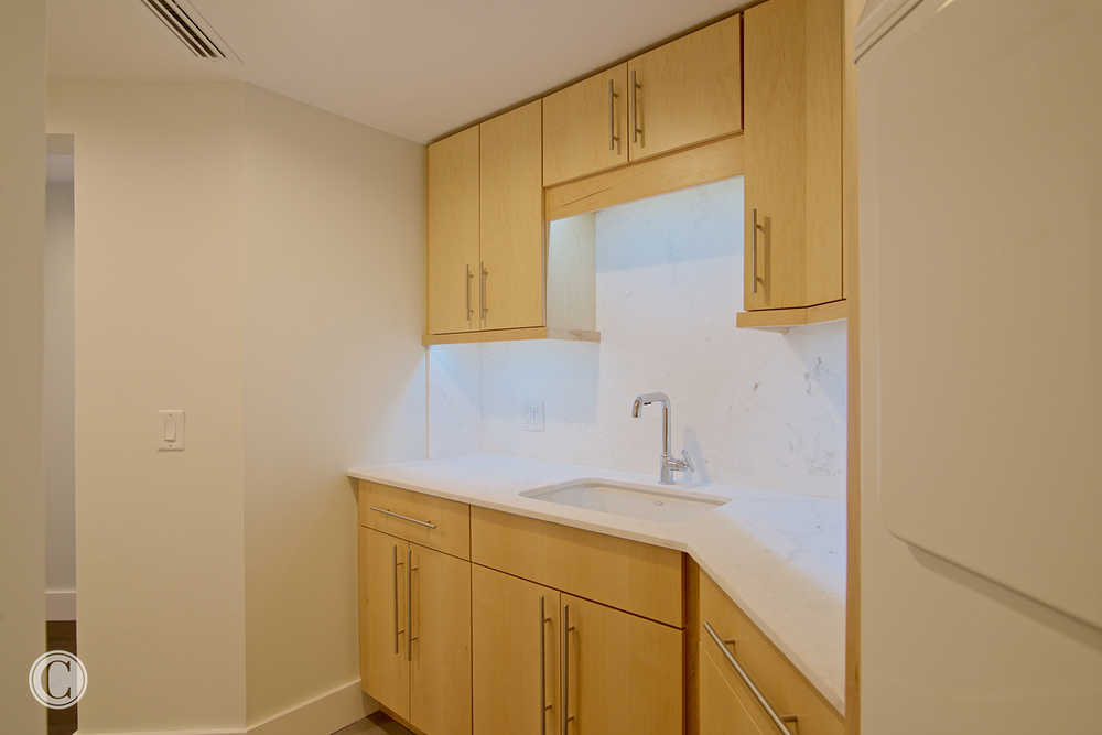 Jax Bch. Renovation, Acquilis Condominium, Laundry Room, ©Wally Sears Photography