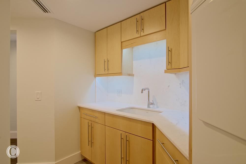 Jax Bch. Renovation, Acquilis Condominium, Laundry Room | Cornelius Construction Company