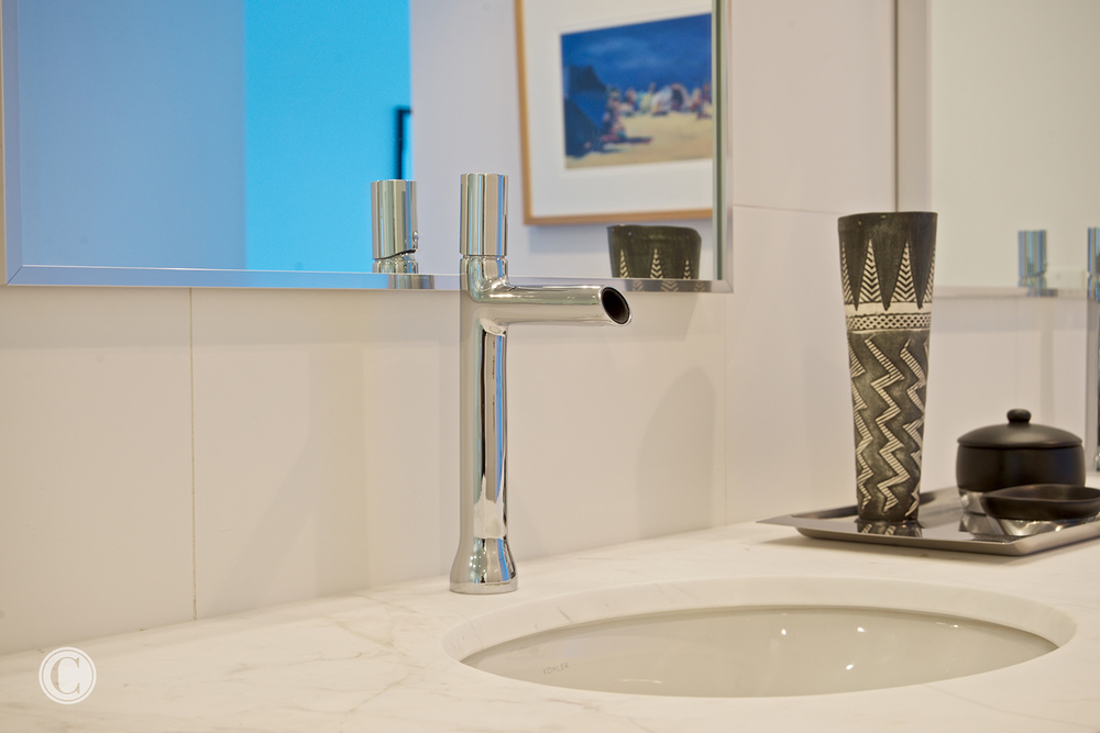 Jax Bch. Renovation, Acquilis Condominium, Guest Bathroom Sink | Cornelius Construction Company