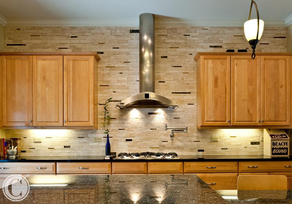 Kitchen Upgrades - designer tile backsplash, Pot-filling faucet, Granite Counters, ©Mark Sain Wilson Photography