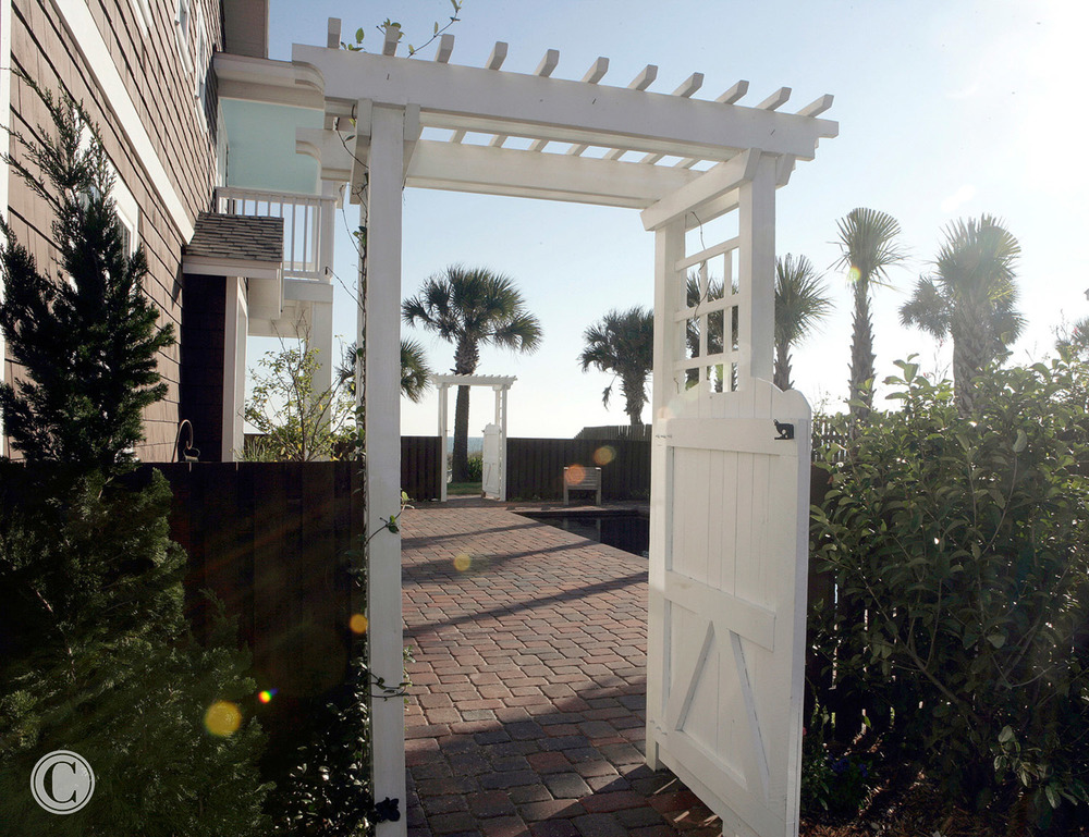 Enter though Gate to Front Door, Full Gut-Remodel, Classic Oceanfront Beach House, Neptune Beach, FL ©Pablo Rivera Photography