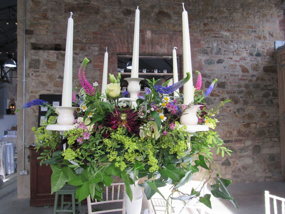 Candelabra  'Sally's flowers were beautifully romantic and natural.She was a joy to work with and created the perfect scheme for our wedding day, with none of the fuss.'  Cliodhna and Myles