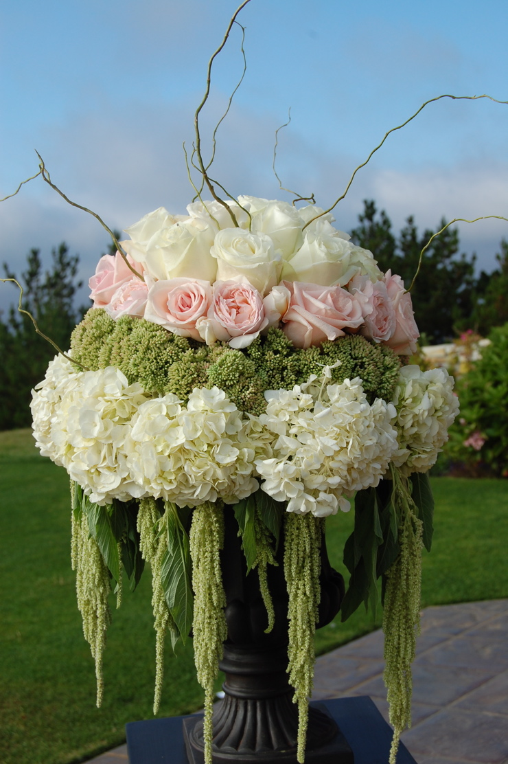 Draping Floral - Amaranthus – It's back! Just another example of how trends can come back around. So many couples are asking to incorporate amaranthus in their décor. The cascading bloom gives floral pieces a lush feel and the bold color adds some interest.  *Photo extracted from Pinterest for reference.