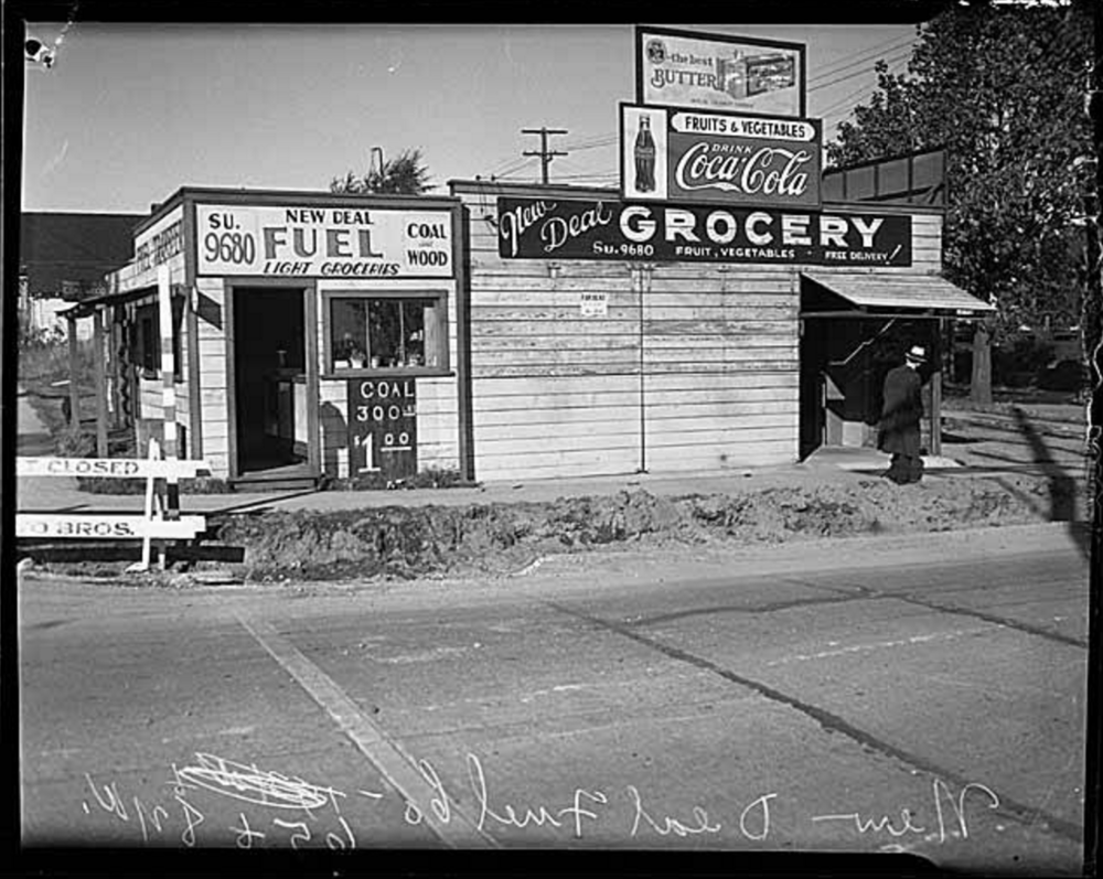 Perhaps our bottle was purchased at New Deal Fuel. This little grocery store was located at the corner of 65th & 8th Ave NW, a short walk from Drew and Jacob's house. This photo was snapped in 1935. Credit: Museum of History & Industry