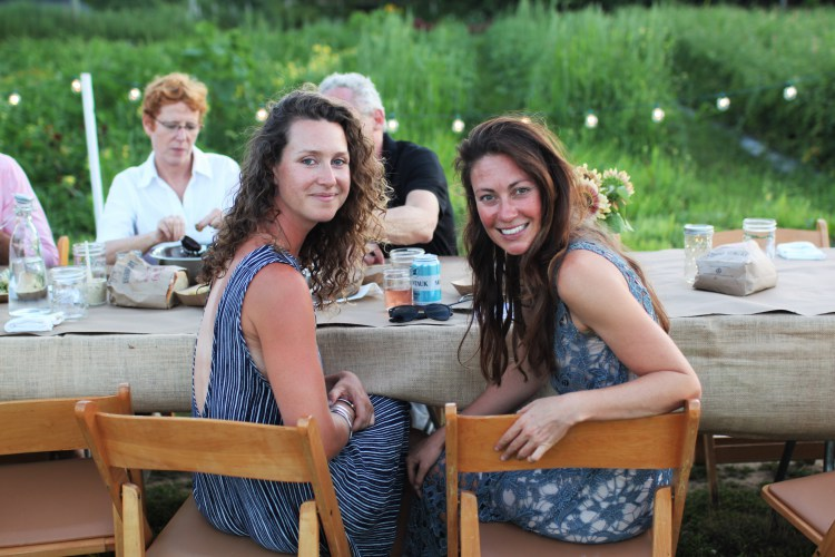 Amanda Merrow and Katie Baldwin at an Amber Waves Farm Copper Oven Dinner in 2015