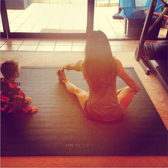 """Morning stretches on my amazing yoga mat. It's HUGE so I can change positions without moving my mat and Ryder can play with his toys next to me and not feel left out"" - Fitness Model, Sophie Guidolin"