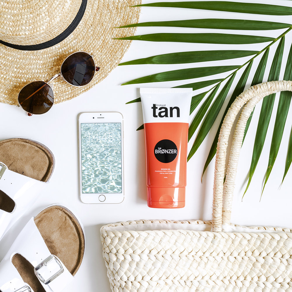 styled beach essentials flatlay photo