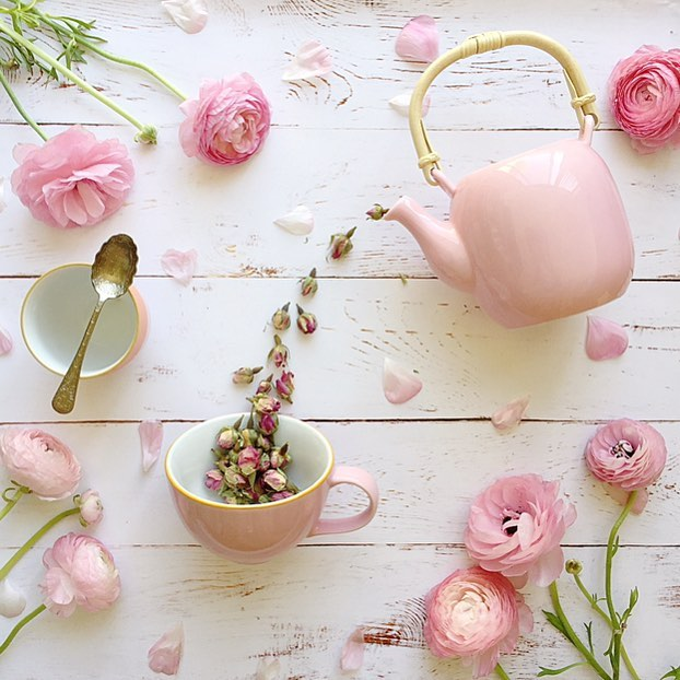 pink tea and flowers flatlay