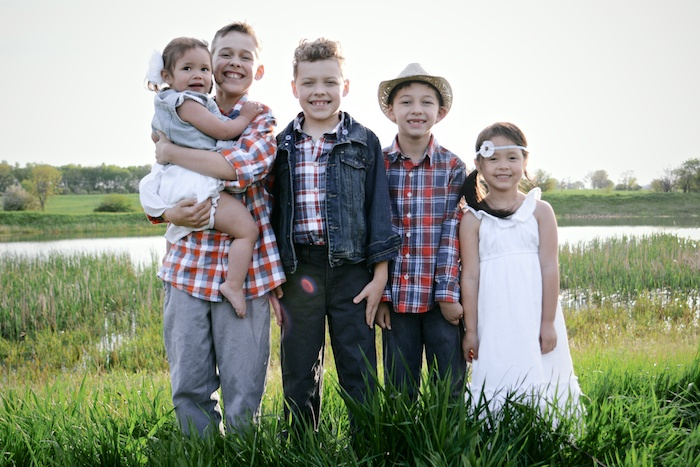 Image of Becky's five children--three sons and two daughters--standing in a field