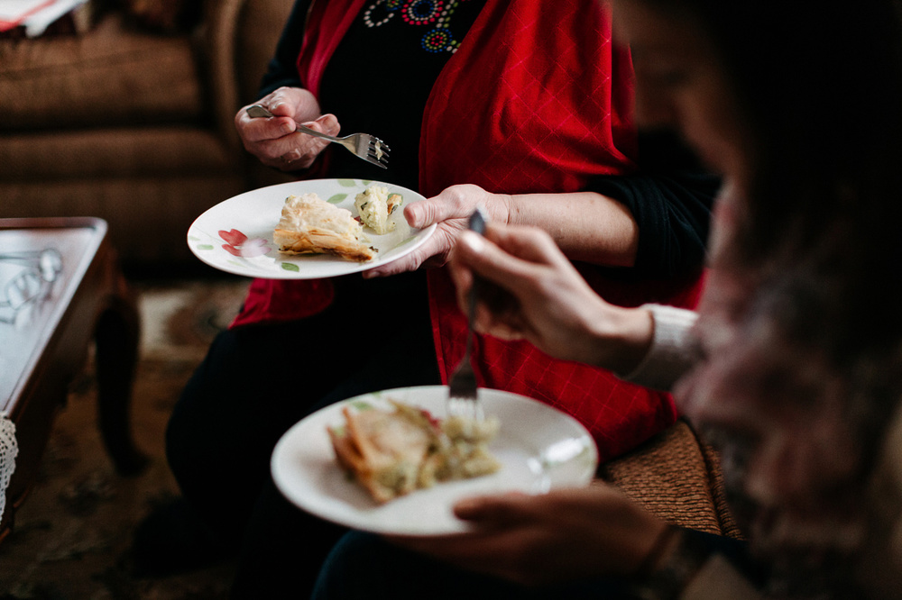 Hospitality and the gospel. Image displays two women sharing a meal together.