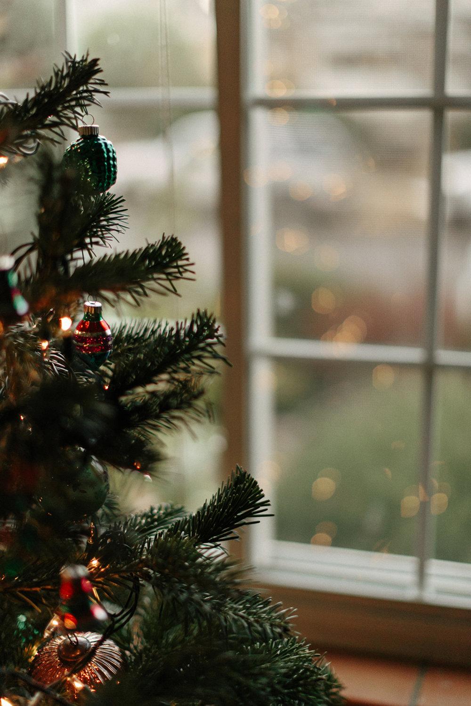 Simplifying Christmastime, christmas tree in window.