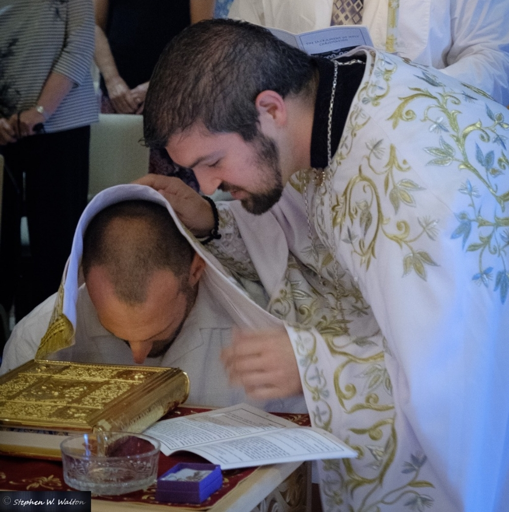 Theophan receives the prayer of absolution prior to the start of the Divine Liturgy