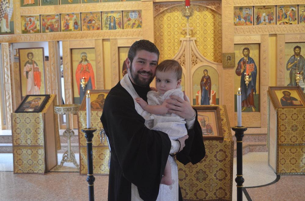 WEW baptism 2 2019 with Fr. Gabriel.JPG