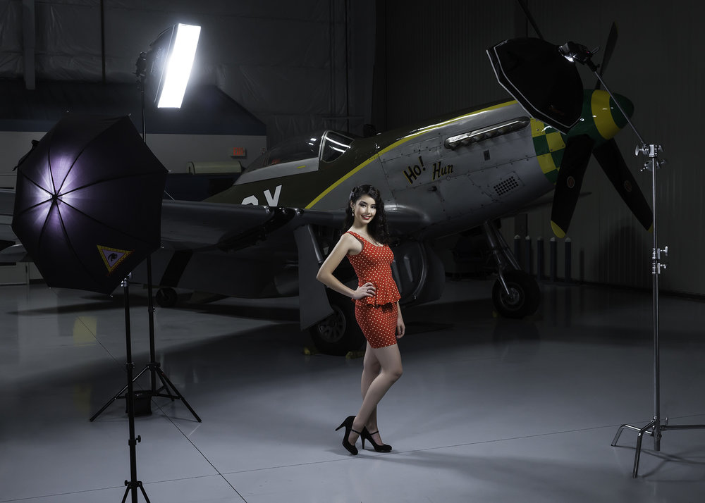 Here, model, Paulina Silva pose with the backdrop of a WWI P-51 Mustang