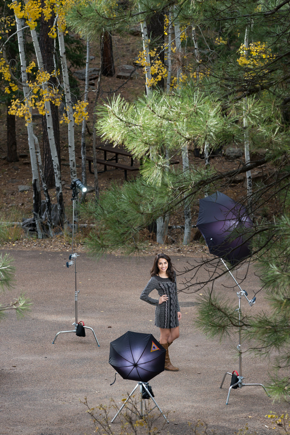 Classic three-point lighting for an outdoor portrait provides the lighting in this pull-back photo