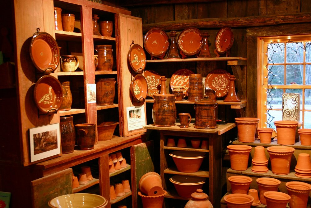 Redware pots in the shop today .